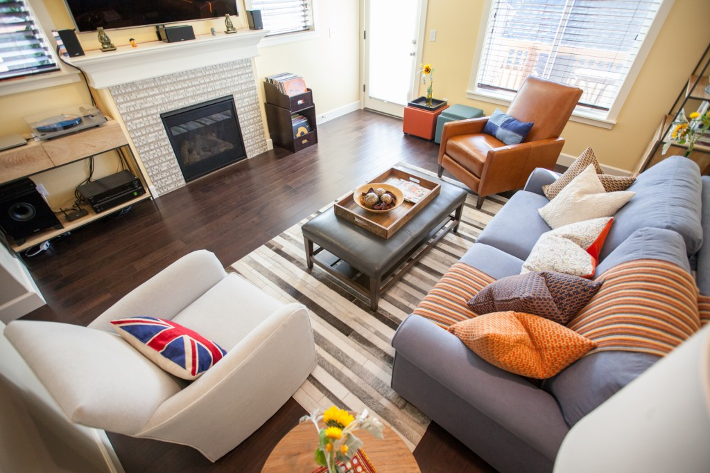 Living room with cowhide area rug